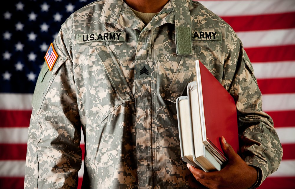 US Army Veteran Carrying Textbooks Under Arm