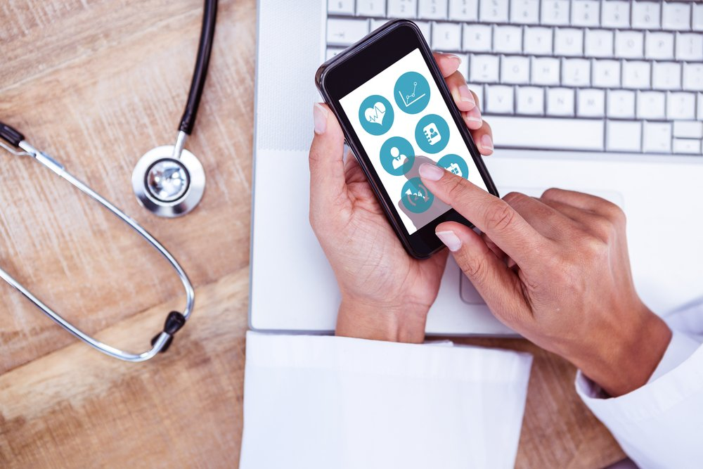 Medical student looking at app on phone