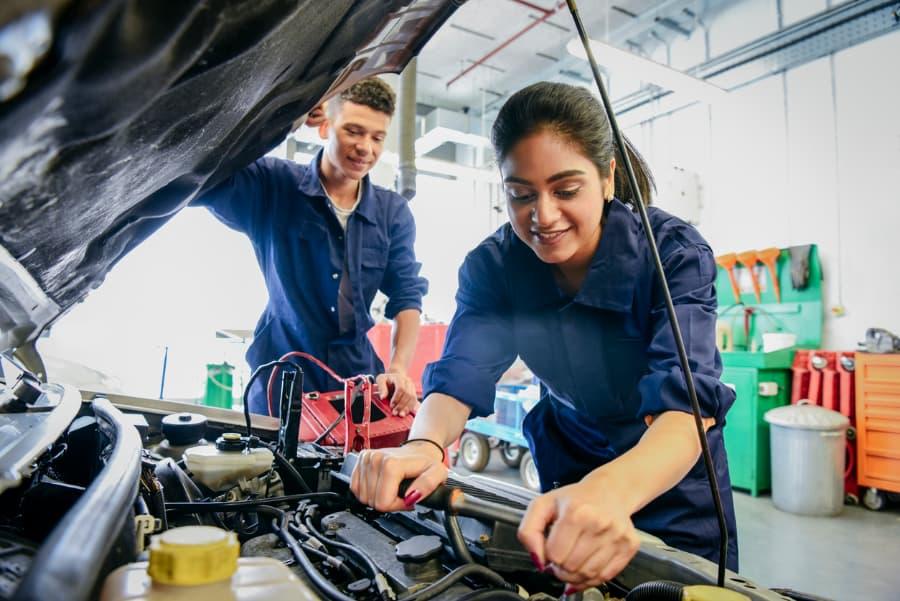 Student mechanics working on car